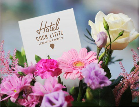 A pink, yellow and purple floral arrangement made at Hotel Rock Lititz